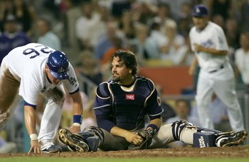 LOS ANGELES - JULY 25:  Mike Piazza #33 of the San Diego Padres sits on homeplate after tagging out Toby Hall #26 of the Los Angeles Dodgers in the sixth inning on July 25, 2006 at Dodger Stadium in Los Angeles, California.  (Photo by Lisa Blumenfeld/Gett
