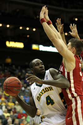 KANSAS CITY, MO - MARCH 09:  Quincy Acy #4 of the Baylor Bears looks to pass the ball against the Oklahoma Sooners during their game in the first round of the 2011 Phillips 66 Big 12 Men's Basketball Tournament at Sprint Center on March 9, 2011 in Kansas