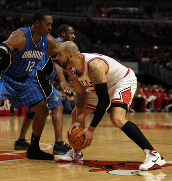 CHICAGO, IL - JANUARY 28: Carlos Boozer #5 of the Chicago Bulls prepares to move against Dwight Howard #12 of the Orlando Magic at the United Center on January 28, 2011 in Chicago, Illinois. The Bulls defeated the Magic 99-90. NOTE TO USER: User expressly