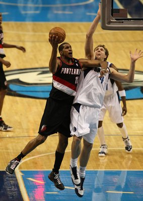 DALLAS - FEBRUARY 04: LaMarcus Aldridge #12 of the Portland Trail Blazers takes a shot against Dirk Nowitzki #21 of the Dallas Mavericks on February 4, 2009 at American Airlines Center in Dallas, Texas.  NOTE TO USER: User expressly acknowledges and agree