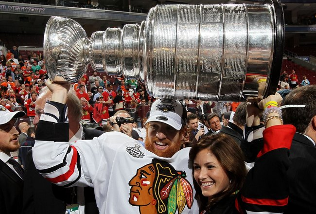 PHILADELPHIA - JUNE 09:  Brian Campbell #51 of the Chicago Blackhawks hoists the Stanley Cup after teammate Patrick Kane scored the game-winning goal in overtime to defeat the Philadelphia Flyers 4-3 and win the Stanley Cup in Game Six of the 2010 NHL Sta