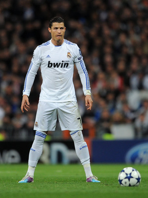 MADRID, SPAIN - MARCH 16:  Cristiano Ronaldo of Real Madrid lines up a free kick during the UEFA Champions League round of 16 second leg match between Real Madrid and Lyon at Estadio Santiago Bernabeu on March 16, 2011 in Madrid, Spain.  (Photo by Jasper