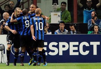 MILAN, ITALY - APRIL 20:  Maicon (2nd R) of Inter Milan celebrates his 2:1 goal with teammates Goran Pandev, Samuel Eto'o and Wesley Sneijder during the UEFA Champions League Semi Final First Leg match between Inter Milan and Barcelona at Giuseppe Meazza