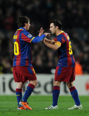 BARCELONA, SPAIN - MARCH 08:  Lionel Messi (L) of Barcelona celebrates with Xavi Hernandez during the UEFA Champions League round of 16 second leg match between Barcelona and Arsenal on March 8, 2011 in Barcelona, Spain.  (Photo by Jasper Juinen/Getty Ima