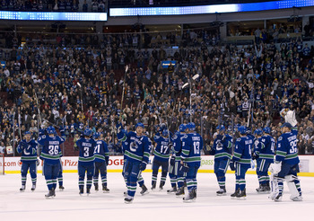 VANCOUVER, CANADA - MARCH 31: The Vancouver Canucks salut their fans after defeating the Los Angeles Kings in NHL action on March 31, 2011 at Rogers Arena in Vancouver, BC, Canada.  (Photo by Rich Lam/Getty Images)