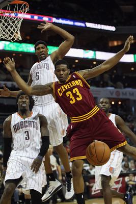 CHARLOTTE, NC - DECEMBER 29:  Alonzo Gee #33 of the Cleveland Cavaliers looses the ball against the Charlotte Bobcats during their game at Time Warner Cable Arena on December 29, 2010 in Charlotte, North Carolina. NOTE TO USER: User expressly acknowledges