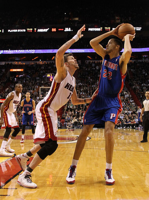 MIAMI, FL - JANUARY 28:  Tayshaun Prince #22 of of the Detroit Pistons passes over Mike Miller #13 of the Miami Heat during a game at American Airlines Arena on January 28, 2011 in Miami, Florida. NOTE TO USER: User expressly acknowledges and agrees that,