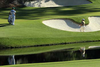 AUGUSTA, GA - APRIL 10:  Lee Westwood of England plays a bunker on the 12th hole as his caddie Billy Foster looks on during the third round of the 2010 Masters Tournament at Augusta National Golf Club on April 10, 2010 in Augusta, Georgia.  (Photo by Davi