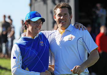 NEWPORT, WALES - OCTOBER 04:  Rory McIlroy of Europe embraces Lee Westwood on the 18th green after he halved his match in the singles matches during the 2010 Ryder Cup at the Celtic Manor Resort on October 4, 2010 in Newport, Wales.  (Photo by David Canno