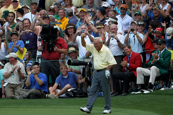 AUGUSTA, GA - APRIL 07:  Arnold Palmer celebrates after a long putt during the Par 3 Contest prior to the 2010 Masters Tournament at Augusta National Golf Club on April 7, 2010 in Augusta, Georgia.  (Photo by Jamie Squire/Getty Images)