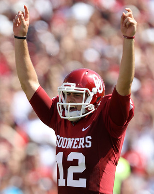 NORMAN, OK - SEPTEMBER 11:  Quarterback Landry Jones #12 of the Oklahoma Sooners celebrates a touchdown against the Florida State Seminoles in the first quarter at Gaylord Family Oklahoma Memorial Stadium on September 11, 2010 in Norman, Oklahoma.  (Photo