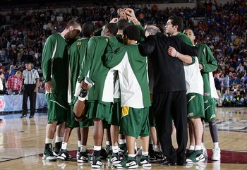 INDIANAPOLIS - APRIL 01:  The George Mason Patriots gather before the start of the second half against the Florida Gators during the semifinal game of the NCAA Men's Final Four on April 1, 2006 at the RCA Dome in Indianapolis, Indiana.  (Photo by Streeter