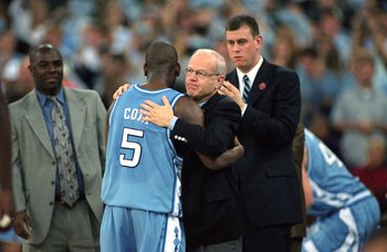Head Coach Bill Guthridge hugs Ed Cota #5 of the North Carolina Tar Heels during the NCAA Men''s Finals Four Game against the Florida Gators at the RCA Dome in Indianapolis, Indiana. The Gators defeated the Tar Heels 71-59.
