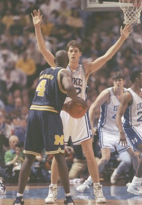 6 Apr 1992:  Forward Chris Webber of the Michigan Wolverines tries to fend off center Christian Laettner of the Duke Blue Devils during a playoff game at the Hubert H. Humphrey Metrodome in Minneapolis, Minnesota.  Duke won the game 71-51. Mandatory Credi