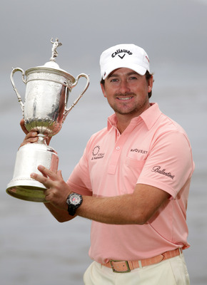PEBBLE BEACH,CA - JUNE 20: Graeme McDowell of Northern Ireland  celebrates with the trophy on the 18th green after winning the 110th U.S. Open at Pebble Beach Golf Links on June 20,2010 in Pebble Barch, California. (Photo by Andrew Redington/Getty Images)