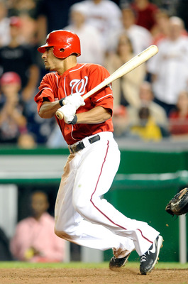 WASHINGTON - AUGUST 26:  Ian Desmond #6 of the Washington Nationals singles in the game winning run in the thirteenth inning against the St. Louis Cardinals at Nationals Park on August 26, 2010 in Washington, DC.  The Nationals won the game 11-10.  (Photo