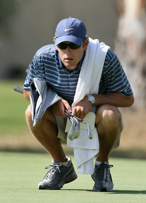RANCHO MIRAGE, CA - SEPTEMBER 17:  Tim Vickers, caddie to Michelle Wie, examines the thrid hole green during the second round of the LPGA Q-School Sectional Qualifying at Mission Hills Country Club on September 17, 2008 in Rancho Mirage, California.  (Pho