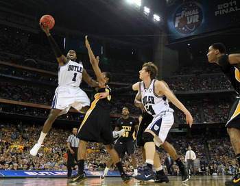 HOUSTON, TX - APRIL 02:  Shelvin Mack #1 of the Butler Bulldogs goes to the hoop against Bradford Burgess #20 of the Virginia Commonwealth Rams during the National Semifinal game of the 2011 NCAA Division I Men's Basketball Championship at Reliant Stadium
