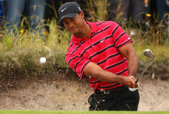 MELBOURNE, AUSTRALIA - NOVEMBER 14:  Tiger Woods of the USA chips in out of the bunker on the 2nd hole during round four of the Australian Masters at The Victoria Golf Club on November 14, 2010 in Melbourne, Australia.  (Photo by Ryan Pierse/Getty Images)