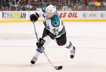 GLENDALE, AZ - MARCH 26:  Marc-Edouard Vlasic #44 of the San Jose Sharks shoots the puck during the NHL game against the Phoenix Coyotes at Jobing.com Arena on March 26, 2011 in Glendale, Arizona. The Sharks defeated the Coyotes 4-1.  (Photo by Christian