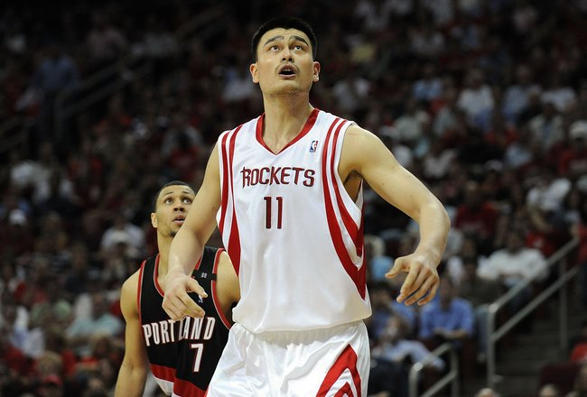 HOUSTON - APRIL 30:  Center Yao Ming #11 of the Houston Rockets and Brandon Roy #7 of the Portland Trail Blazers in Game Six of the Western Conference Quarterfinals during the 2009 NBA Playoffs at Toyota Center on April 30, 2009 in Houston, Texas. NOTE TO