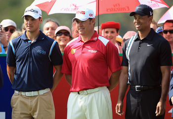 DUBAI, UNITED ARAB EMIRATES - FEBRUARY 10:  Lee Westwood of England the world's number 1, is flanked by Martin Kaymer of Germany (left) the world's number 2, and Tiger Woods of the USA (right) the world's number 3, on the 1st tee during the first round of