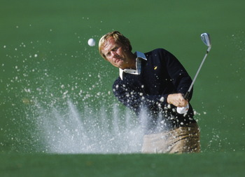 Jack Nicklaus of the USA chips out of the sand bunker during the US Masters Golf Tournament on 12th April 1986 at the Augusta National Golf Club in Augusta, Georgia, USA.  (Photo by David Cannon/Getty Images)