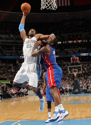 DENVER, CO - MARCH 12:  Nene #31 of the Denver Nuggets is fouled by Ben Gordon #7 of the Detroit Pistons as he goes to the basket at the Pepsi Center on March 12, 2011 in Denver, Colorado. NOTE TO USER: User expressly acknowledges and agrees that, by down