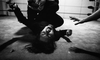 SYDNEY, AUSTRALIA - JULY 16: Zander Bathory screams out in pain after being put in a leg lock by the European Assassin during the AWF Dojo Wrestling night July 16, 2004 in Sydney, Australia. For this group of die-hard sports professionals who spend most S