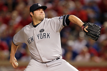 ARLINGTON, TX - OCTOBER 15:  Joba Chamberlain #62 of the New York Yankees throws a pitch against the Texas Rangers in Game One of the ALCS during the 2010 MLB Playoffs at Rangers Ballpark in Arlington on October 15, 2010 in Arlington, Texas.  (Photo by Ro
