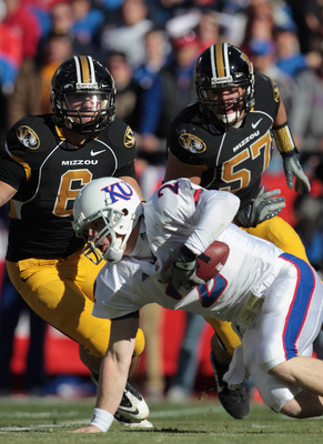 KANSAS CITY, MO - NOVEMBER 27:  Quarterback Jordan Webb #2 of the Kansas Jayhawks is sacked by Andrew Gochkar #6 and Brad Madison #57 of the Missouri Tigers during the game on November 27, 2010 at Arrowhead Stadium in Kansas City, Missouri.  (Photo by Jam