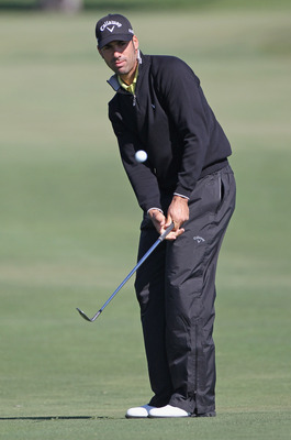 DORAL, FL - MARCH 11:  Alvaro Quiros of Spain hits a pitch shot on the eighth hole during the completion of the first round of the 2011 WGC- Cadillac Championship at the TPC Blue Monster at the Doral Golf Resort and Spa on March 11, 2011 in Doral, Florida