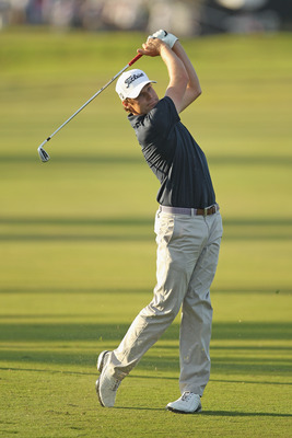 DORAL, FL - MARCH 13:  Nick Watney hits his approach shot on the 18th hole during the final round of the 2011 WGC- Cadillac Championship at the TPC Blue Monster at the Doral Golf Resort and Spa on March 13, 2011 in Doral, Florida.  (Photo by Mike Ehrmann/