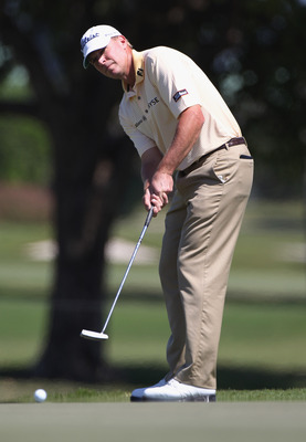 DORAL, FL - MARCH 13:  Steve Stricker hits a putt during the final round of the 2011 WGC- Cadillac Championship at the TPC Blue Monster at the Doral Golf Resort and Spa on March 13, 2011 in Doral, Florida.  (Photo by Sam Greenwood/Getty Images)