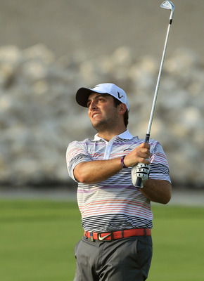 BAHRAIN, BAHRAIN - JANUARY 30:  Francesco Molinari of Italy plays his second shot at the 18th hole during the final round of the 2011 Volvo Champions held at the Royal Golf Club on January 30, 2011 in Bahrain, Bahrain.  (Photo by David Cannon/Getty Images
