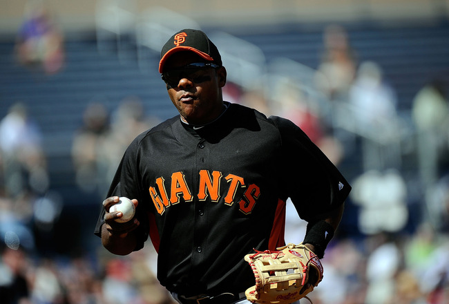 PEORIA, AZ - MARCH 08:  Miguel Tejada #10 of the San Francisco Giants holds the baseball as he runs to the dugout against Seattle Mariners during the spring training baseball game against at Peoria Stadium on March 8, 2011 in Peoria, Arizona.  (Photo by K