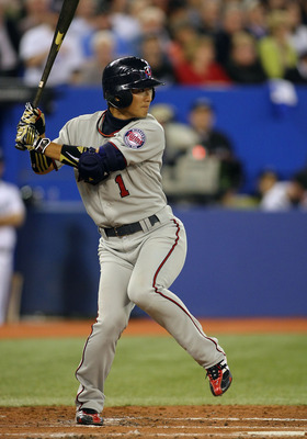 TORONTO,CANADA - APRIL 1:  Tsuyoshi Nishioka #1 of the Minnesota Twins bats against the Toronto Blue Jays on opening day during their MLB game at the Rogers Centre April 1, 2011 in Toronto, Ontario, Canada.(Photo By Dave Sandford/Getty Images)