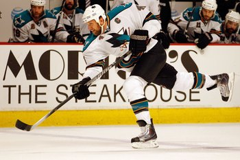 CHICAGO - MAY 21:  Rob Blake #4 of the San Jose Sharks slaps the puck while taking on the Chicago Blackhawks in Game Three of the Western Conference Finals during the 2010 NHL Stanley Cup Playoffs at the United Center on May 21, 2010 in Chicago, Illinois.