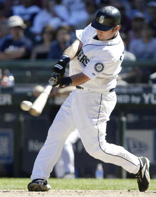 SEATTLE - AUGUST 27:  Chris Snelling #32 of the Seattle Mariners doubles in the fifth inning against the Boston Red Sox on August 27, 2006 at Safeco Field in Seattle Washington. The Mariners defeated the Red Sox 6-3.  (Photo by Otto Greule Jr/Getty Images