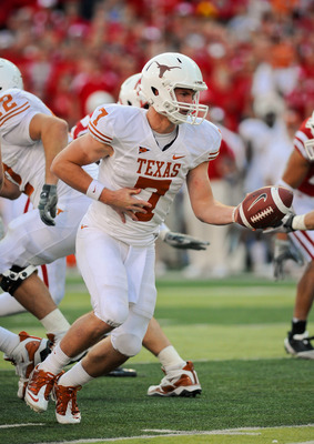LINCOLN, NE - OCTOBER 16: Quarterback Garrett Gilbert #7 of the Texas Longhorns prepares to hand the ball off during their game at Memorial Stadium on October 16, 2010 in Lincoln, Nebraska. Texas Defeated Nebraska 20-13. (Photo by Eric Francis/Getty Image