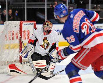 NEW YORK, NY - MARCH 24: Craig Anderson #41 of the Ottawa Senators makes a pad save on a shot on goal by Erik Christensen #26 of the New York Rangers at Madison Square Garden on March 24, 2011 in New York City. (Photo by Christopher Pasatieri/Getty Images