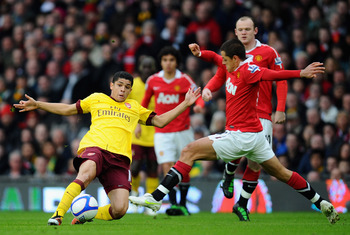 MANCHESTER, ENGLAND - MARCH 12:  Denilson of Arsenal and Javier Hernandez of Manchester United challenge for the ball during the FA Cup sponsored by E.On Sixth Round match between Manchester United and Arsenal at Old Trafford on March 12, 2011 in Manchest