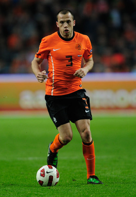 AMSTERDAM, NETHERLANDS - MARCH 29:  John Heitinga of the Netherlands in action during the Group E, EURO 2012 Qualifier between Netherlands and Hungary at the Amsterdam Arena on March 29, 2011 in Amsterdam, Netherlands.  (Photo by Jamie McDonald/Getty Imag