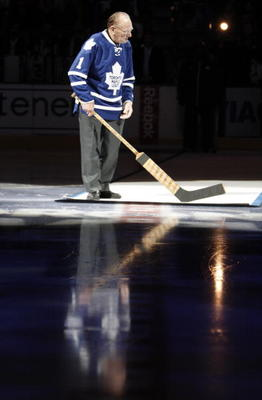 TORONTO, CANADA - OCTOBER 07: Leaf Hall of Famer Johnny Bower take part   in the pre-game ceremony before the Toronto Maple Leafs take on the Montreal Canadiens during a regular season NHL game at the Air Canada Centre October 7, 2010 in Toronto, Ontario,