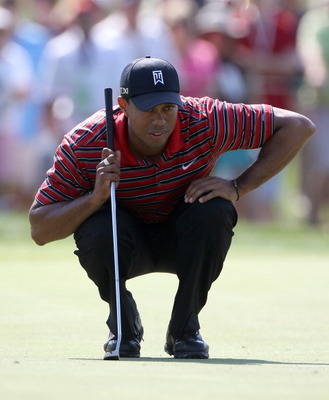 ORLANDO, FL - MARCH 27:  Tiger Woods plays a shot on the 3rd hole during the final round of the Arnold Palmer Invitational presented by MasterCard at the Bay Hill Club and Lodge on March 27, 2011 in Orlando, Florida.  (Photo by Sam Greenwood/Getty Images)