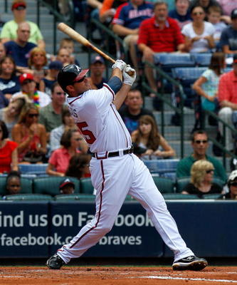 ATLANTA - MAY 31:  Troy Glaus #25 of the Atlanta Braves hits a double in the first inning off an error by the Philadelphia Phillies at Turner Field on May 31, 2010 in Atlanta, Georgia.  (Photo by Kevin C. Cox/Getty Images)