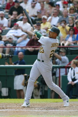 ARLINGTON, TEXAS - APRIL 11:  Right fielder David Justice #23 of the Oakland Athletics watches the flight of the ball during the MLB game against the Texas Rangers at The Ballpark in Arlington, Texas on April 11, 2002. The Rangers won 7-0. (Photo by Ronal