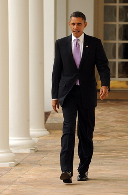WASHINGTON, DC - JANUARY 25:  (AFP OUT) U.S. President Barack Obama walks through the Colonnade of the Rose Garden of the White House on January 25, 2011 in Washington, DC. Later this evening Obama will give his State of the Union Address to the Joint Ses