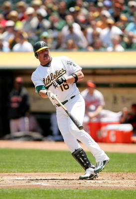 OAKLAND, CA - JUNE 07:  Jason Giambi #16 of the Oakland Athletics tosses his bat after being walked in the first inning of their game against the Baltimore Orioles at the Oakland Coliseum on June 7, 2009 in Oakland, California. Orlando Cabrera #18 scored