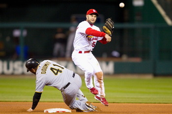 ST. LOUIS, MO - APRIL 4: Skip Schumaker #55 of the St. Louis Cardinals turns a double play against the Pittsburgh Pirates at Busch Stadium on April 4, 2011 in St. Louis, Missouri.  (Photo by Dilip Vishwanat/Getty Images)